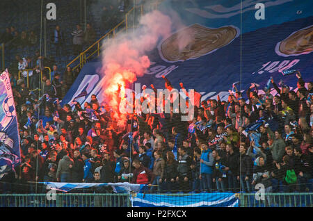 Dnipro, Ukraine - October 12, 2013: Celebrating anniversary of victories of FC Dnipro in USSR Championship in 1983 and 1988. Football hooligans burn f - Stock Photo