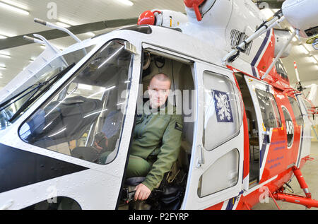 Pilsen, Czech Republic. 13th June, 2018. The first Sokol army helicopter (W-3A Sokol, 0718) with 5000 flight hours in the world belongs to air rescue service with airbase in Line village, near Pilsen, Czech Republic. On the photo is seen pilot Petr Safarik in the cockpit of the helicopter in a hangar on June 13, 2018. Credit: Miroslav Chaloupka/CTK Photo/Alamy Live News - Stock Photo
