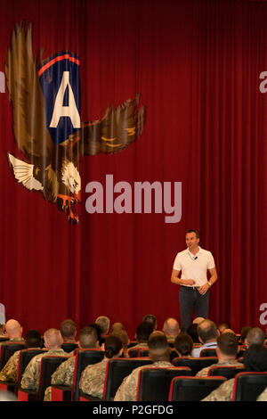 U.S. Army Secretary Eric Fanning takes to stage during a town hall meeting September 19 with Soldiers at Camp Arifjan, Kuwait. The top Army civilian spoke to a filled auditorium of more than 200 Soldiers from primarily U.S. Army Central about the current state of the Army in its unique time of shrinking budgets and multiple missions throughout the Middle East. (U.S. Army photo by Sgt. Brandon Hubbard) - Stock Photo