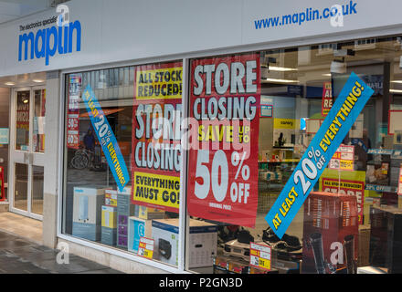 a maplin store on the high street offering items for sale closing down.  internet shopping demise of the high street for retailers. store closing down - Stock Photo