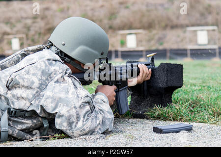 U.S. Army Pfc. Abu Shayed, a culinary specialist assigned to the New York Army National Guard 145th Maintenance Battalion, fires an M4A1 Carbine on a zero range at Camp Smith Training Site, 20 September 2016. The Soldiers were qualifying in order to go on State Active Duty to reinforce Joint Task Force Empire Shield, the New York National Guard security force in New York City, at the direction of Governor Andrew M. Cuomo, in response to increased security concerns in the city following a Sept. 17 bomb attack there. (U.S. Army National Guard photo by Sgt. Michael Davis) - Stock Photo
