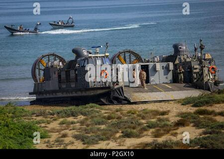 A U.S. Navy Landing Craft Air Cushioned (LCAC) with Assault Craft Unit 4 prepares to transport U.S. and international citizens during a bilateral non-combatant evacuation exercise at the U.S. Embassy, Muscat, Oman, Sept. 21, 2016. The non-combatant evacuation exercise is an opportunity for the United States and Oman to practice a bilateral mission of quickly providing security and safety to U.S. and international citizens abroad during a natural disaster or contingency. (U.S. Marine Corps photo by Sgt. Lauren A. Falk/Released) - Stock Photo