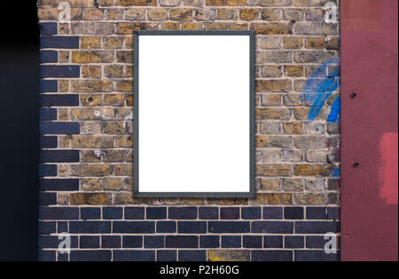 Blank advertising A1 poster billboard on brick wall - Stock Photo