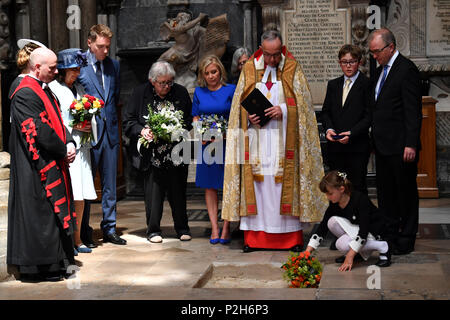Dean of Westminster John Hall (third right), accompanied by first wife Jane Hawking (second left) and daughter Lucy Hawking (centre), presides over the internment of the ashes of scientist Professor Stephen Hawking in the nave during a memorial service at Westminster Abbey, London. - Stock Photo