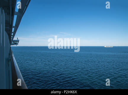 View of the rear of the pilot bridge of a cruise ship  large area of calm ocean with tanker on background - Stock Photo