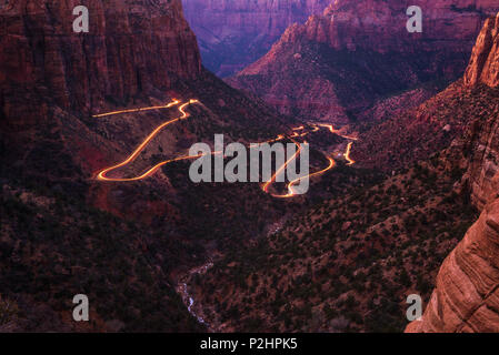 Road in Zion National Park with car light trails - Stock Photo