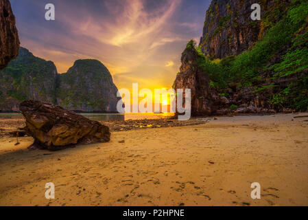 Sunset at the Maya beach on Koh Phi Phi island in Thailand - Stock Photo