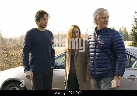 Original Film Title: THE X-FILES: I WANT TO BELIEVE.  English Title: THE X-FILES: I WANT TO BELIEVE.  Film Director: CHRIS CARTER.  Year: 2008.  Stars: DAVID DUCHOVNY; GILLIAN ANDERSON; CHRIS CARTER. Credit: CRYING BOX PROD./TEN THIRTEEN PRODUCTIONS / PERA, DIYAH / Album - Stock Photo