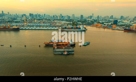 aerial view of klong tuey port and container ship loading rice paddy over chaopraya river heart of bangkok thailand capital - Stock Photo