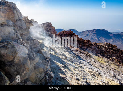 Smouldering summit crater of active volcano Mount Teide at 3718 metres on Tenerife the largest of the Canary Islands - Stock Photo