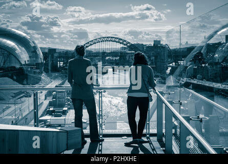 View over the River Tyne towards The Gateshead Sage and Tyne Bridge from viewing platform in BALTIC Centre for Contemporary Art. Gateshead. UK - Stock Photo