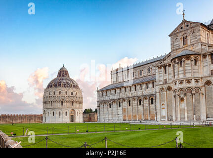 Piazza dei Miracoli (Square of Miracles) or Piazza del Duomo (Cathedral Square) with Pisa Baptistery and Pisa Cathedral in the morning light, Pisa, Tu - Stock Photo