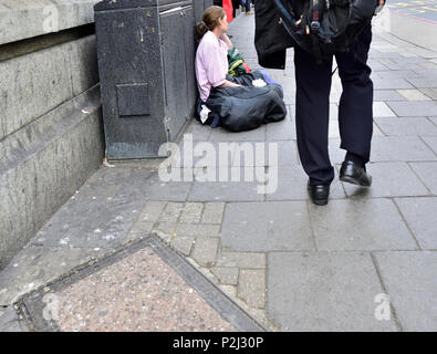 Homeless woman in central London, England, UK. - Stock Photo