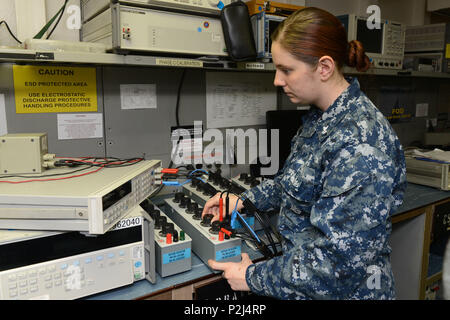 MAYPORT, Fla. (Sept. 28, 2016) – Aviation Electronics Technician 2nd Class Holli D. Corcoran calibrates a decade resistor aboard amphibious assault ship USS Iwo Jima (LHD 7). Iwo Jima is currently moored at her homeport of Mayport, Fla. (U.S. Navy photo by Mass Communication Specialist 3rd Class Jered C. Wallem/Released) - Stock Photo