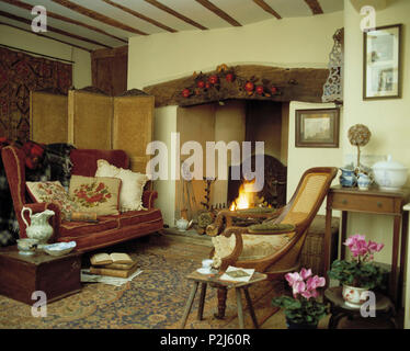 Fireplace in traditional country living room - Stock Photo