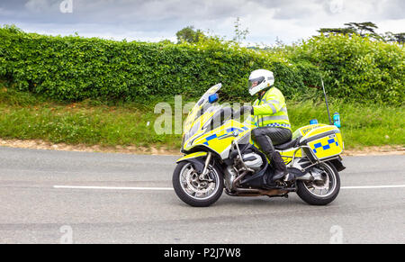 Easton Maudit, Northamptonshire, U.K. Thursday 14th June 2016. Ovo Energy Women's Tour, Stage 2. Rushden to Daventry 145km (91 miles), support vehicle - Stock Photo