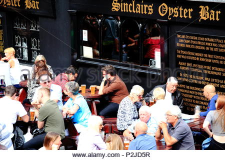 Crowds enjoying an afternoon drink at Sinclairs Oyster Bar at Manchester City Centre, Manchester UK Summer June 2018 - Stock Photo