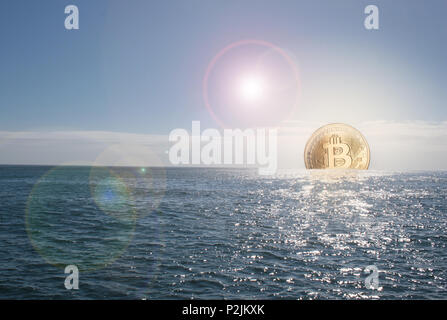 Bitcoin currency rising / sinking concept in ocean and golden bitcoin as the sun - Stock Photo