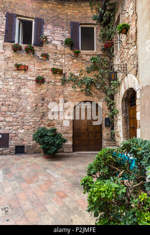 Streets and alleys in the wonderful town of Assisi (Italy) - Stock Photo