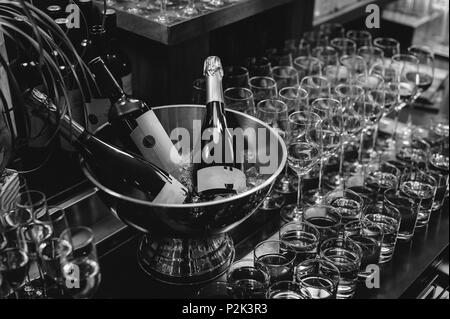 BANQUET reception beautifully served table with a variety of snacks and drinks. glasses of champagne with bubbles, bottle alcoholic drink in ice - Stock Photo
