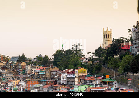Church on the horizon with other buildings in shimla india - Stock Photo