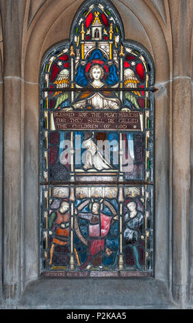 Fort William, Scotland - June 11, 2012: Stained glass at Saint Andrews Church praises Peacemakers showing angels and noblemen. - Stock Photo