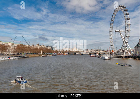 London, UK - April 2018: Cityscape of London from Westminster Bridge with famous London Eye, a giant Ferris wheel by the River Thames - Stock Photo
