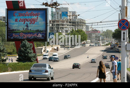 25.08.2016, Tiraspol, Transnistria, Moldova - On the central main street of the 25th October. In front a light-box with political propaganda. Transnis - Stock Photo