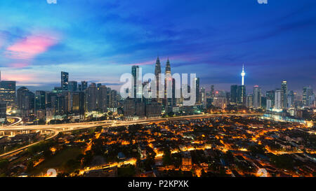Kuala lumpur cityscape. Panoramic view of Kuala Lumpur city skyline during sunrise viewing skyscrapers building and in Malaysia. - Stock Photo