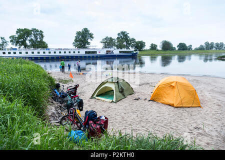 Boat on the river, Camping along the river Elbe, Family bicycle tour along the river Elbe, adventure, from Torgau to Riesa, Saxo - Stock Photo