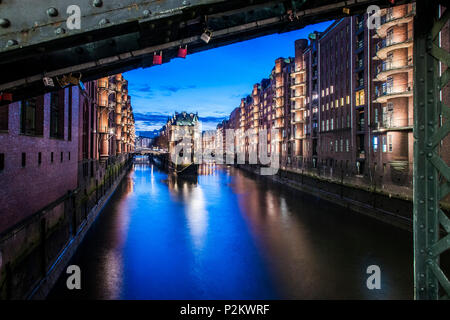 view  to the Watercastle in the old Speicherstadt in the twilight, Hafencity of Hamburg, north Germany, Germany - Stock Photo