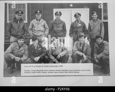 Russell Gackenbach, back center, was the navigator aboard the B-29 Superfortress, Necessary Evil, and is the last surviving member of the three crews that flew the atomic bomb mission over Hiroshima, Japan on Aug. 6, 1945. He is pictured with the Necessary Evil crew during training at Wendover Field, Utah in 1944. (Courtesy Photo) - Stock Photo