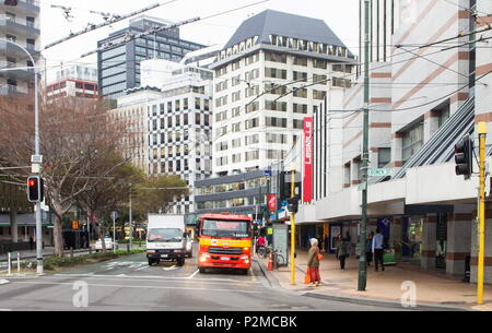 Wellington, New Zealand - 18 July 2016: Pedestrians and vehicles going about their day in downtown Wellington at the corner of Bowen Street and Lambto - Stock Photo