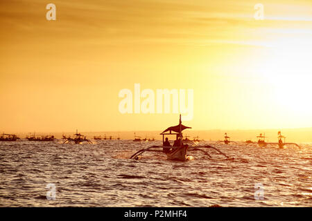 Excursion boats, dolphin watching in the morning, Lovina, Bali, Indonesia - Stock Photo