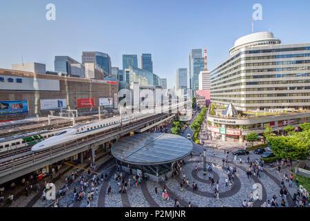 Tokyo International Forum with Shinkansen and Kotsu Kaikan at Yurakucho Station, Chiyoda-ku, Tokyo, Japan - Stock Photo