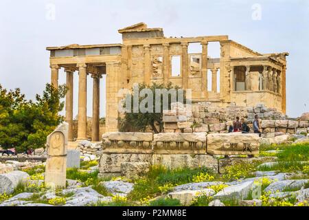Ancient Monument Porch Caryatids Ruins Temple of Erechtheion Acropolis Athens Greece.  Greek maidens columns Temple of Erechtheion for a former Atheni - Stock Photo