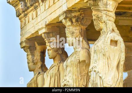 Porch Caryatids Ruins Temple of Erechtheion Acropolis Athens Greece.  Greek maidens columns Temple of Erechtheion for a former Athenian king.  Acropol - Stock Photo