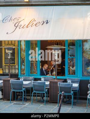Evening at Chez Julien in les Marais, Paris, France - Stock Photo