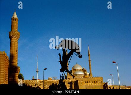 Egypt, Cairo, Citadel District, 1991, the silhouette of a child on a swing stands out against the Muhammad Ali Mosque (19th century, built on the model of Saint Sophia in Istanbul, according to a Turkish architectural tradition) - Stock Photo