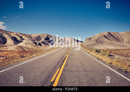 Vintage toned picture of a deserted road, travel concept, USA. - Stock Photo
