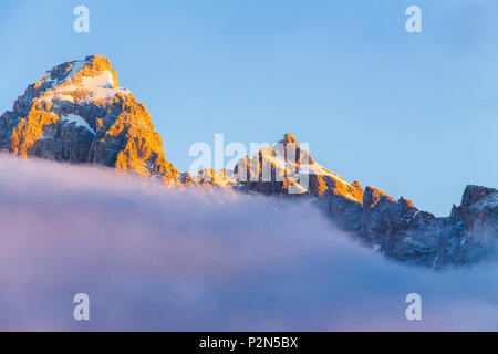Sunrise with morning fog and mist on the Grand Tetons Mountain Range in the Grand Tetons National Park in Wyoming.  The Tetons are the youngest mounta - Stock Photo