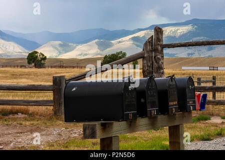 Mailboxes at entrance to farming community off of scenic highway US 89 in southwestern Montana. - Stock Photo
