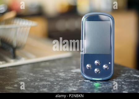Domestic Energy Smart Meter on a Kitchen Worktop with a blank screen for copy space - Stock Photo