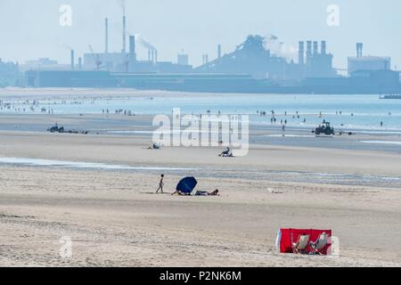 France, Nord, Dunkirk, beach of Malo les Bains and industrial facilities of the Grand Port Maritime of Dunkirk - Stock Photo