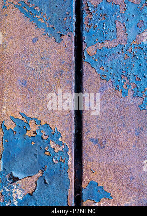 Two rusty metal pink plates with grunge, pealing off blue paint - abstract texture background - Stock Photo
