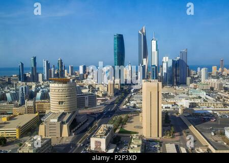 Kuwait, Persian Gulf, Kuwait City, AL Hamra tower in background and Kipco tower at foreground in Central Business district - Stock Photo