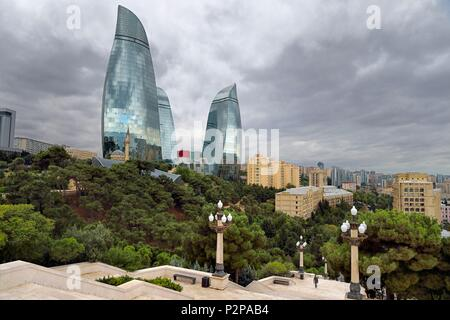 Azerbaijan, Baku, Flame Towers by architects Hellmuth, Obata & Kassabaum and the Shehidler Mosque at his feet, staircase that leads to the Martyrs Memorial in the foreground - Stock Photo