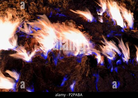 Azerbaijan, Baku, Absheron Peninsula, Yanar Dag meaning burning mountain is a natural gas fire which blazes continuously on a hillside - Stock Photo