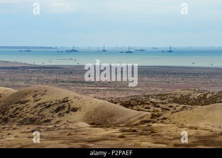 Azerbaijan, Baku Bay, Gobustan, offshore oil rigs in the Caspian Sea - Stock Photo