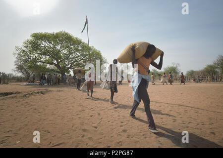 People receive food from the ACT Alliance on April 7, 2017, in Rumading, a village in South Sudan's war-plagued Lol State.